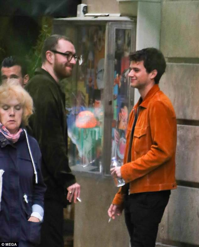 Sam Smith locks lips with beau Brandon Flynn as they pack on the PDA in Spain (Photos)