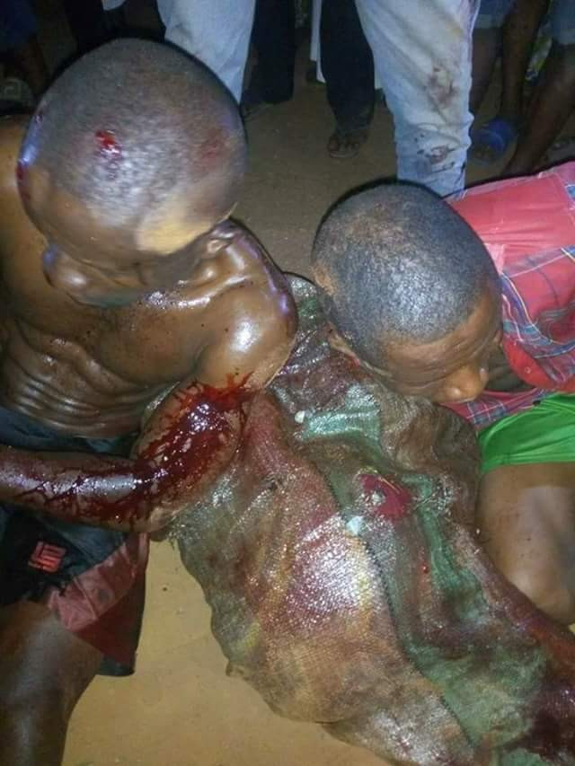 Graphic Photos: Alleged ritual killers caught trying to hide the body of a man they butchered inside a bush in Ogun state