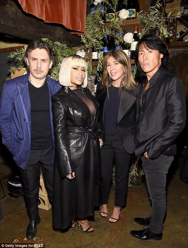 Nicki Minaj flashes cleavage as she dons sheer top and leather coat?to the ELLE x Stuart Weitzman launch (Photos)