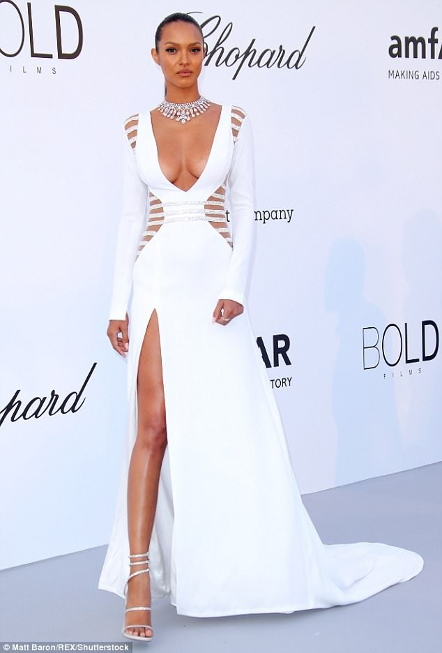 Victoria's Secret model Lais Ribeiro flaunts cleavage in plunging white gown as she arrives for amfAR Gala (Photos)