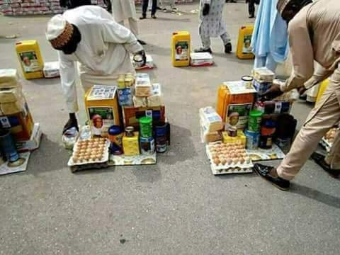 Another photo of Borno youths with their empowerment materials......eggs, beverage, groundnut oil, Bread, others
