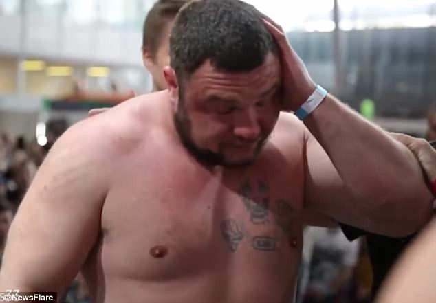 Watch men aggressively slap each other in bizarre Russian slapping competition (Photos/Video)