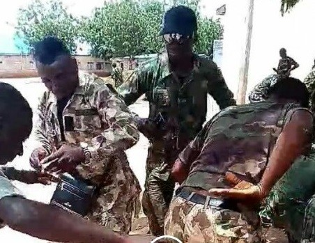 Heartwarming video of young Nigerian soldiers dancing and praising God in the jungle