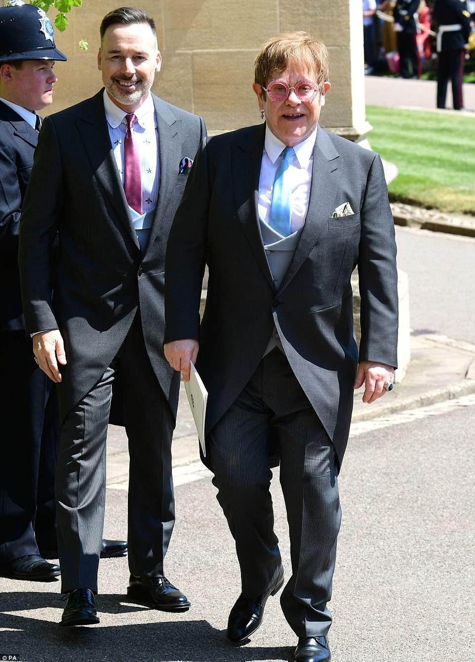 Photos of Sir Elton John and his husband David Furnish at the Royal wedding.