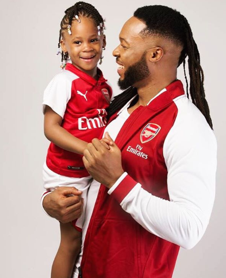 Lovely photos of singer Flavour and his daughters twinning in Arsenal jerseys