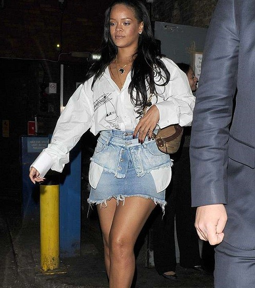 Rihanna puts on a leggy display in denim miniskirt after partying at a London club (Photos)
