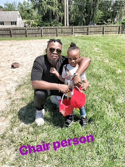 Nigerian rapper Olamide pictured on a school run abroad with his son