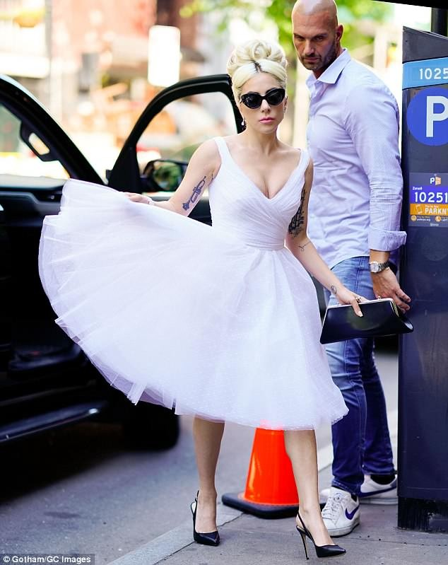 Lady Gaga channels Marilyn Monroe in white sixties-style dress as she steps out in Manhattan (Photos)