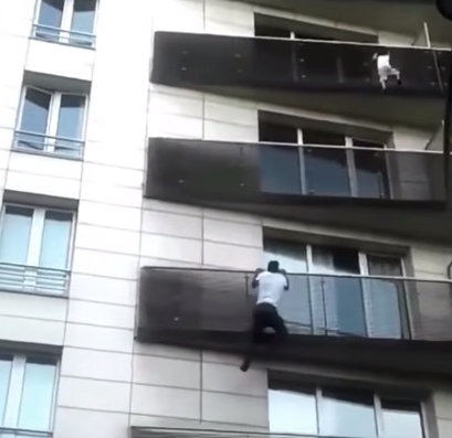 Hero Malian immigrant scales building to rescue a child dangling from a balcony (video)