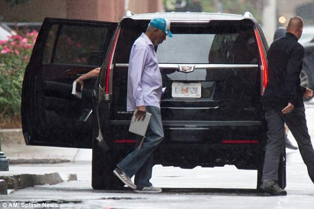 Morgan Freeman hides his face as he is seen for the first time since sexual harassment scandal (Photos)