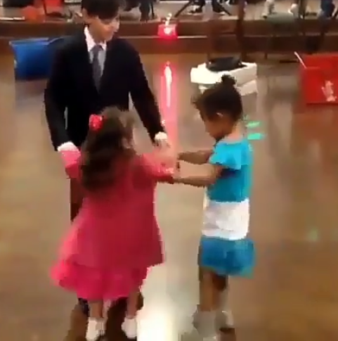 Look what happens when a little girl comes between a boy and his female dance partner (hilarious video)