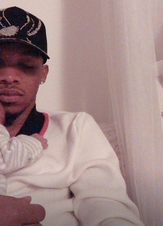 Tekno shares glimpse of himself cuddling newborn daughter Skye