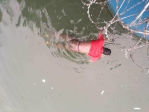 Body of an unindentified man floating on a river in Lagos Island (Photos)