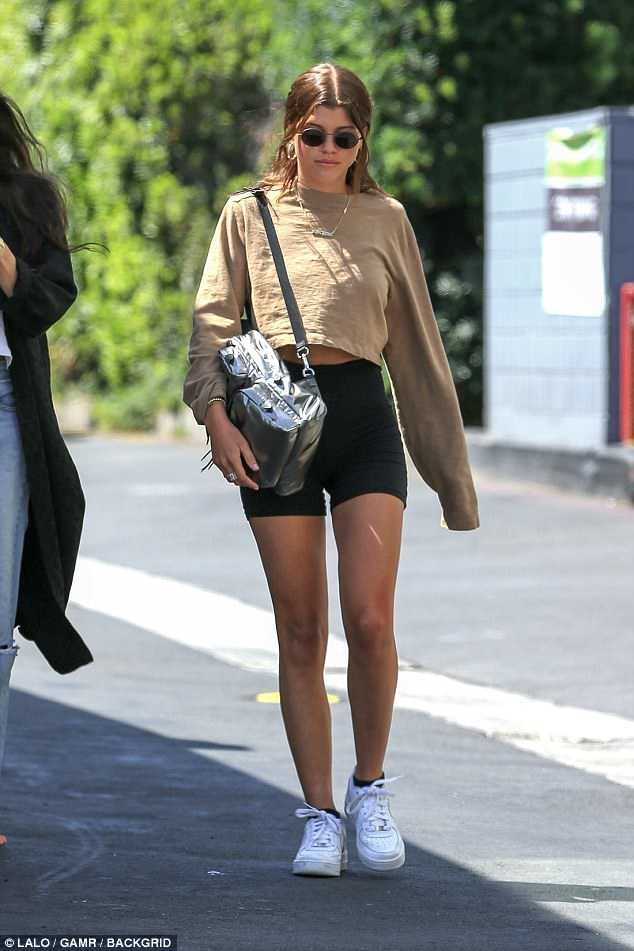 Sofia Richie, 19, keeps a glum face in LA after boyfriend Scott Disick is spotted with another girl at Kanye West