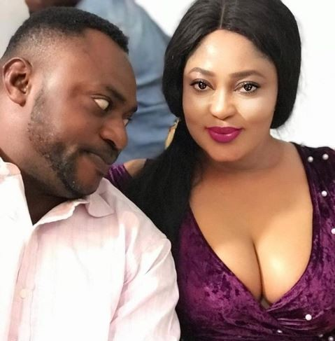 What is?Odunlade Adekola staring at in this photo?