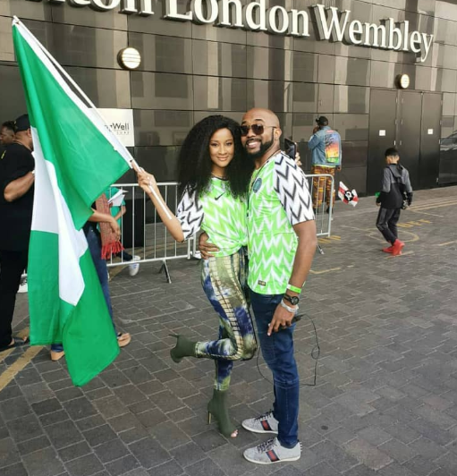 Banky W and  Adesua twinning in their Nigerian jersey at Wembley stadium (photo)