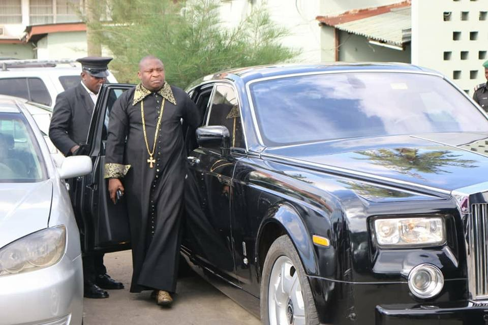 Lagos pastor, Tom Samson, strikes a pose besides his Rolls Royce phantom(photos)