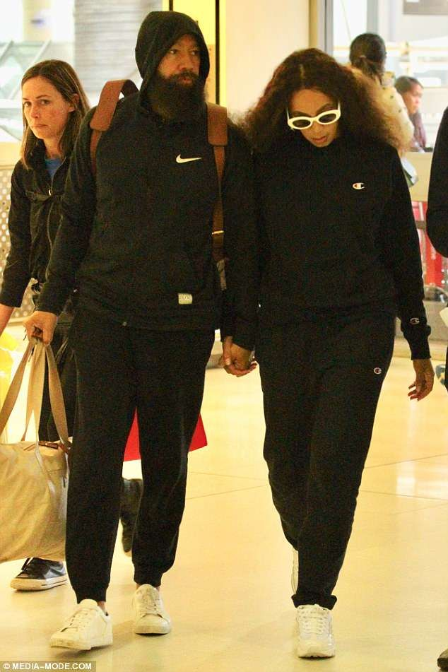 Solange Knowles and her husband Alan Ferguson rock matching tracksuits as they leave Sydney together (Photos)
