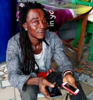 Phone thief caught and given the beating of his life in Lagos during Nigeria vs Czech Republic match (photos)
