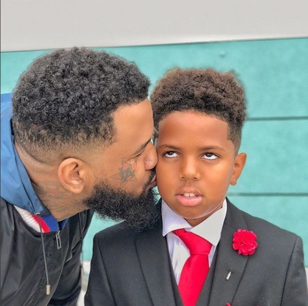 Caption this photo of rapper The Game and his son