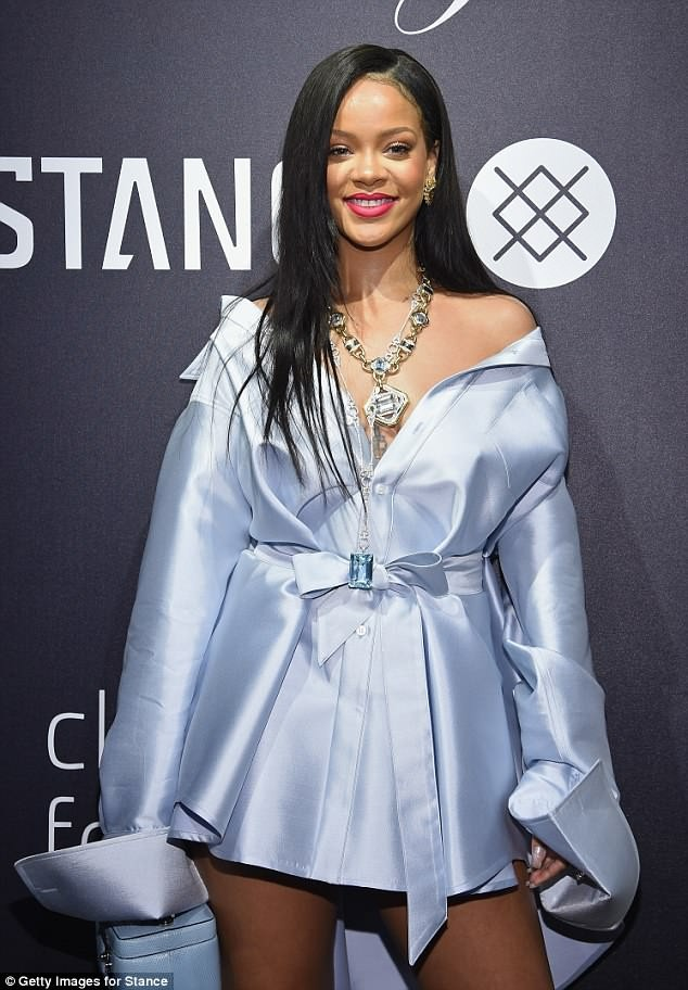 Rihanna stuns in plunging blue shirt dress for New York outing (Photos)