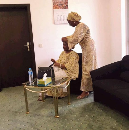 #womensupportingwomen: Cute photo of Dolapo Osinbajo helping Aisha Buhari tie her gele