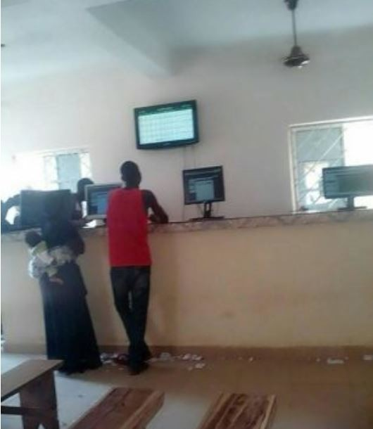 Nursing mother spotted placing a bet on World Cup matches at a betting shop in Lagos (Photos)
