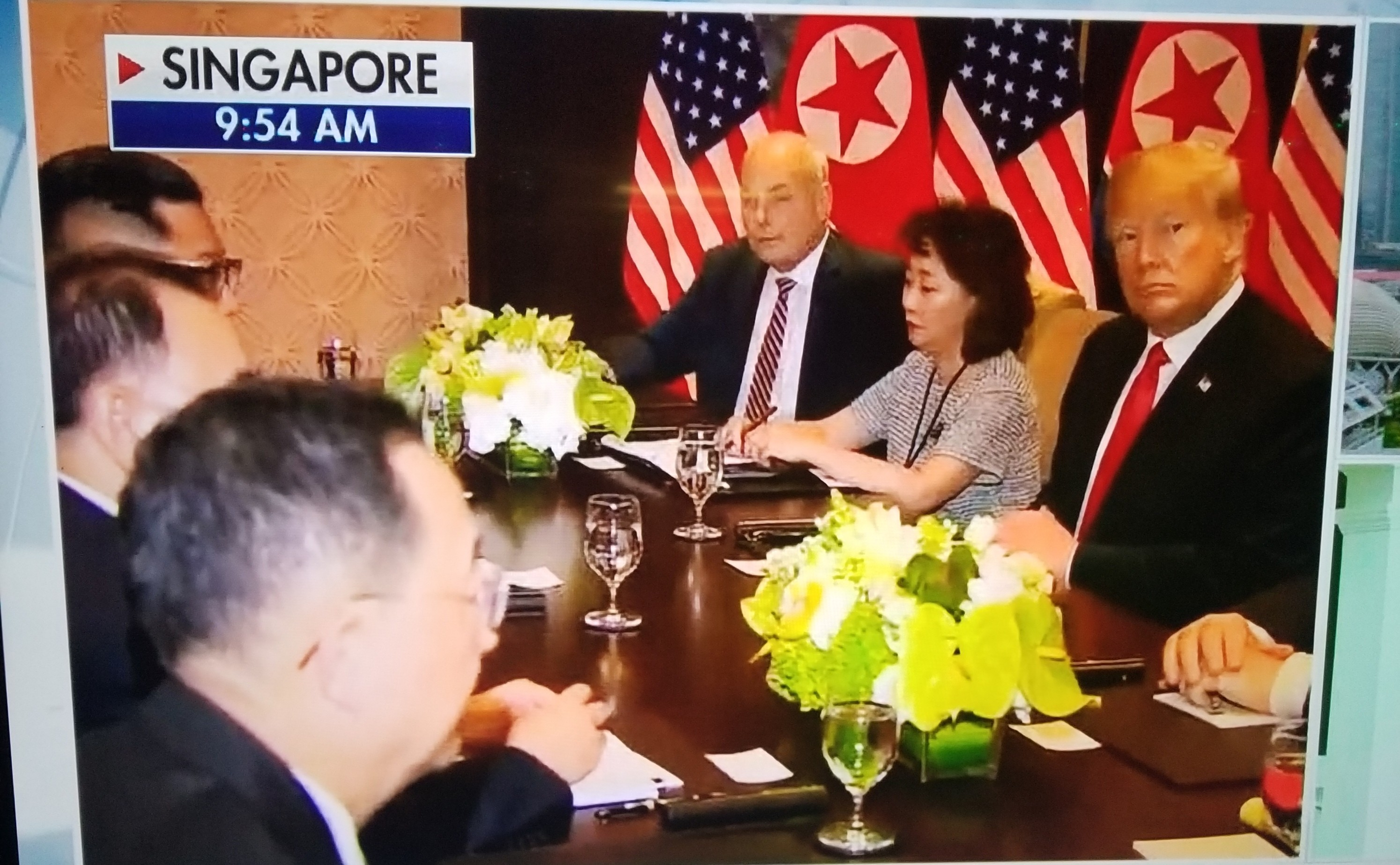 Breaking News: History is made as Donald Trump and Kim Jong Un meet for their summit in Singapore