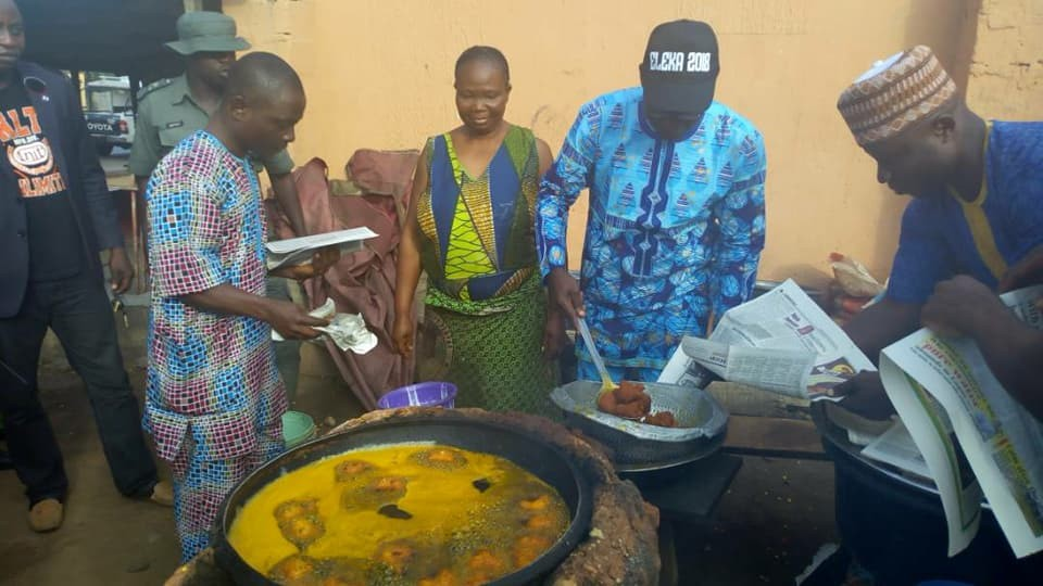 Ekiti PDP governorship candidate, Kolapo Olusola, pictured frying Akara as he campaigns for votes