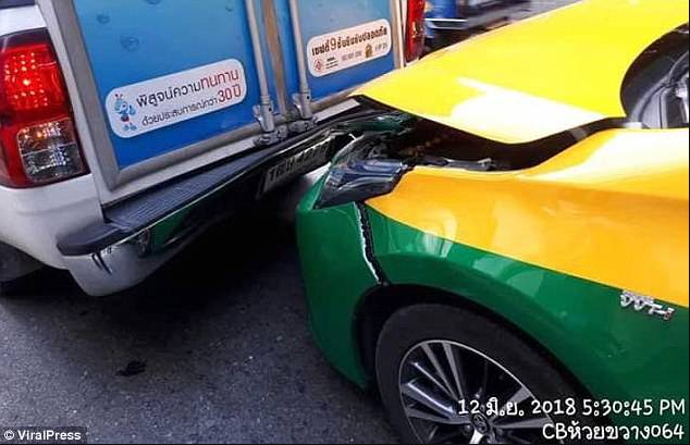 Woman gets eyeliner pencil lodged in her eye as she applies make-up in the back of a taxi and it crashes into a truck (graphic photos)