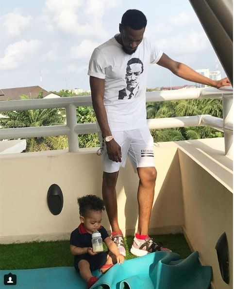 Daddy duties: Dbanj spends time with his cute son Daniel while he?bottle feeds himself (Photos)