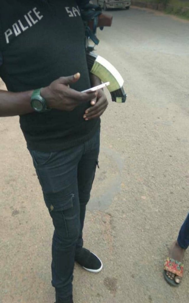 Photos: SARS officers seen searching phone of UNILORIN students