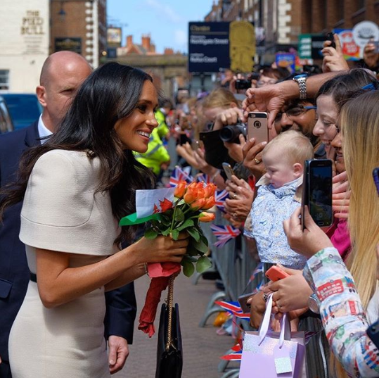 What exactly was The Queen telling Meghan Markle that made her laugh this much in these adorable photos?