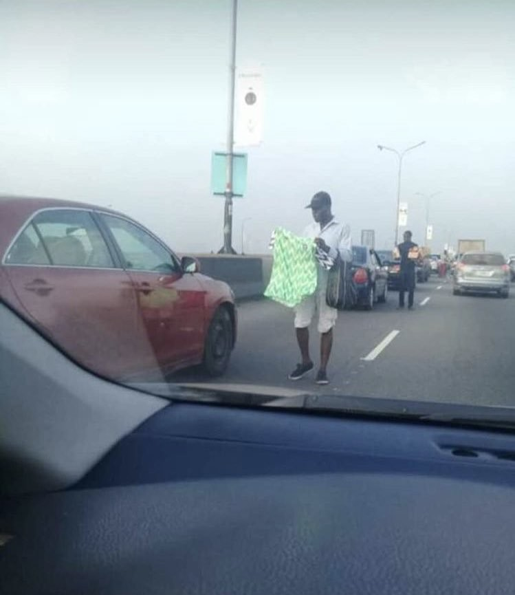 Photo: You can now buy your Nigerian jersey in Lagos traffic.....lol