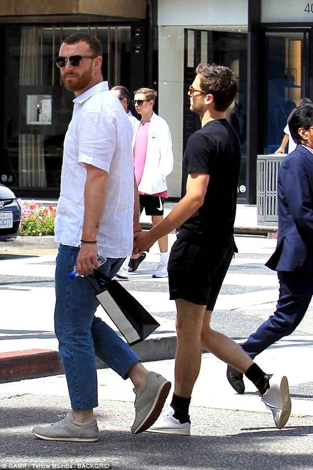 Sam Smith and his boyfriend Brandon Flynn hold hands during shopping trip in LA (Photos)