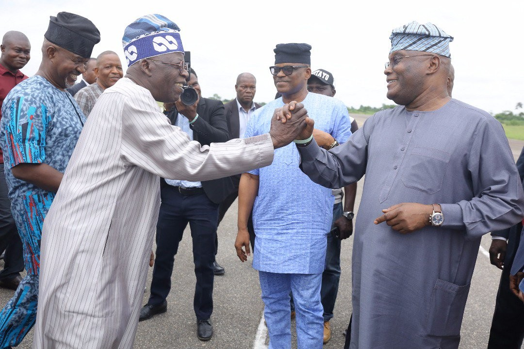 Photos: Tinubu, Atiku hug themselves at Akure airport