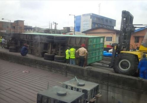 Container falls of the Ojuelegba bridge and lands on many cars