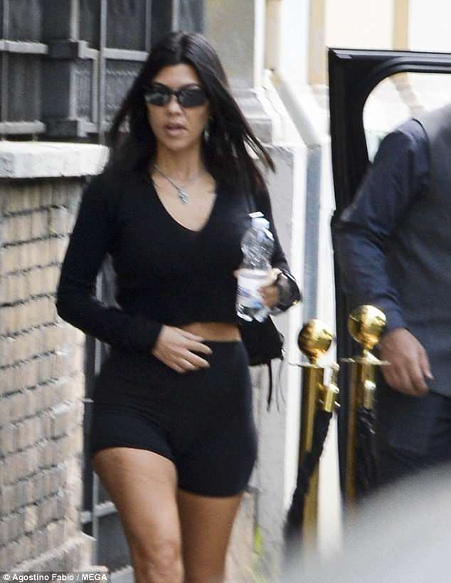 Kourtney Kardashian flaunts her curves in black bicycle shorts in Rome (Photos)