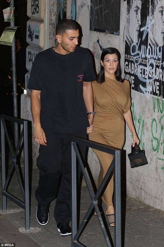 Kourtney Kardashian flaunts her figure in tight beige dress for romantic date night with toyboy beau Younes Bendjima in Rome (Photos)