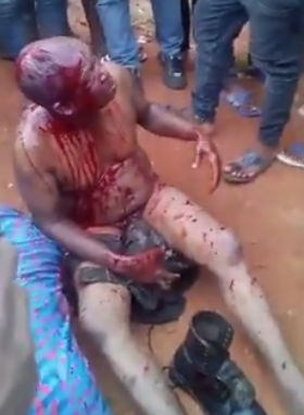 Photos: Police officer beaten and stripped naked for killing woman in Anambra