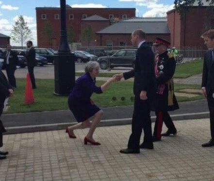 Viral photo of?Prime Minister Theresa May?almost kneeling as she?greets?Prince William. People react!