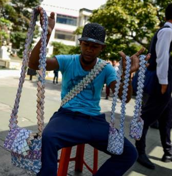 Venezuelans use their currency to make purses as minimum wage cannot even buy bottle of soft drinks. See photos…
