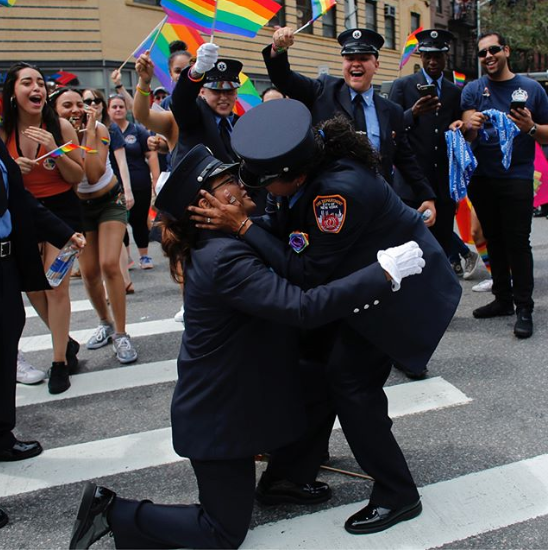 Two fire department medics leave spectators emotional as they get engaged at the Pride parade (photos)