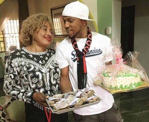 Charles Okocha presents his mum with a tray of