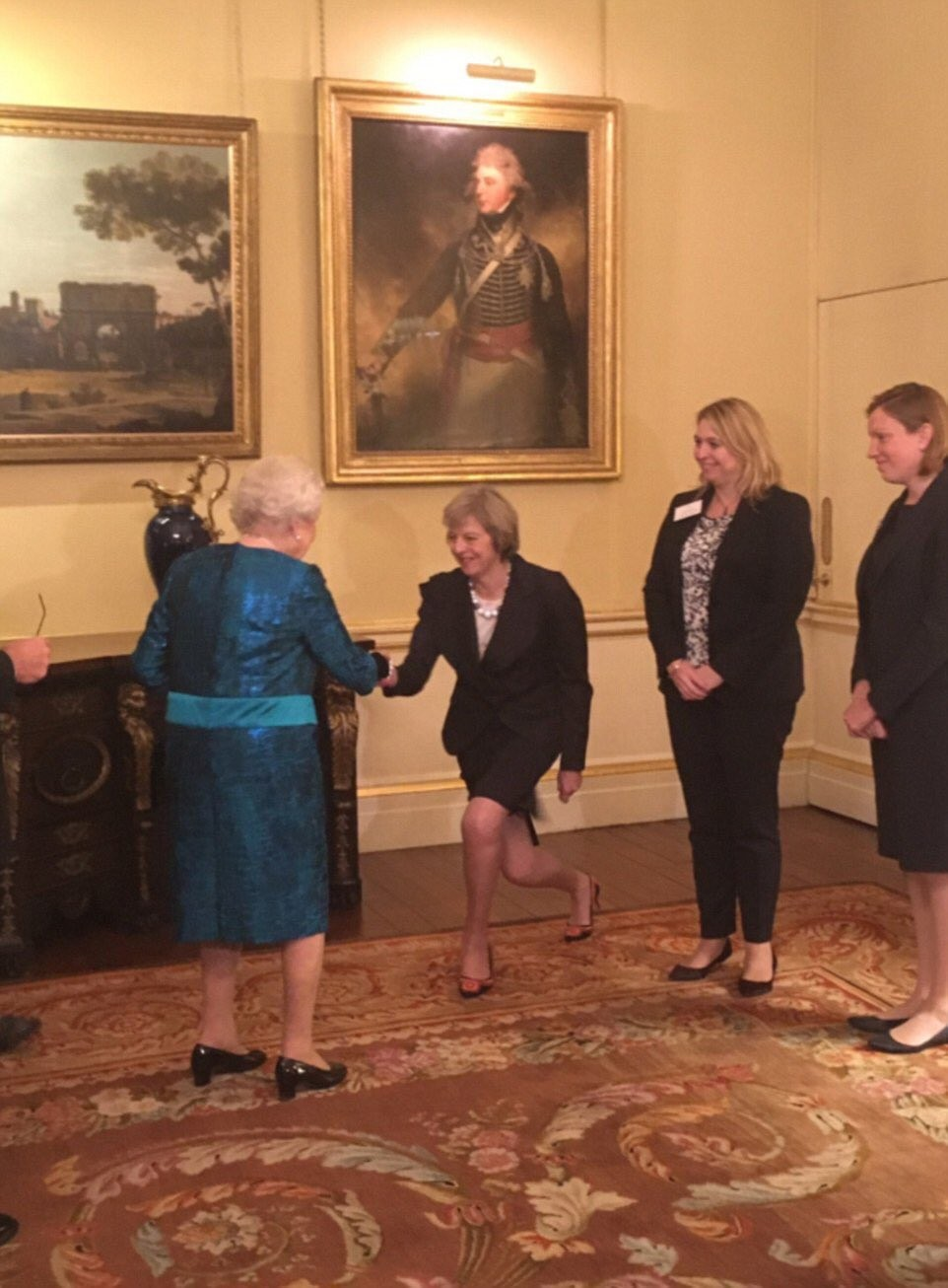 More photos of British Prime Minister Therasa May almost kneeling to greet members of the royal family