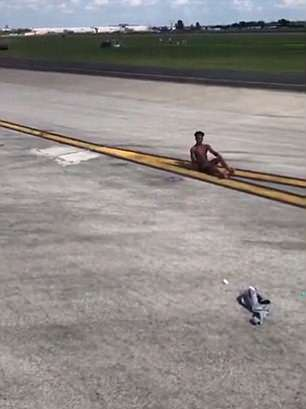 half-naked, VIDEO: Half-naked man sprints toward Delta Air Lines plane at Atlanta airport after he jumped out of his plane and climbed onto the wing of another