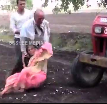 Heartless son uses his elderly mother as a human shield to stop another man from moving his tractor in India