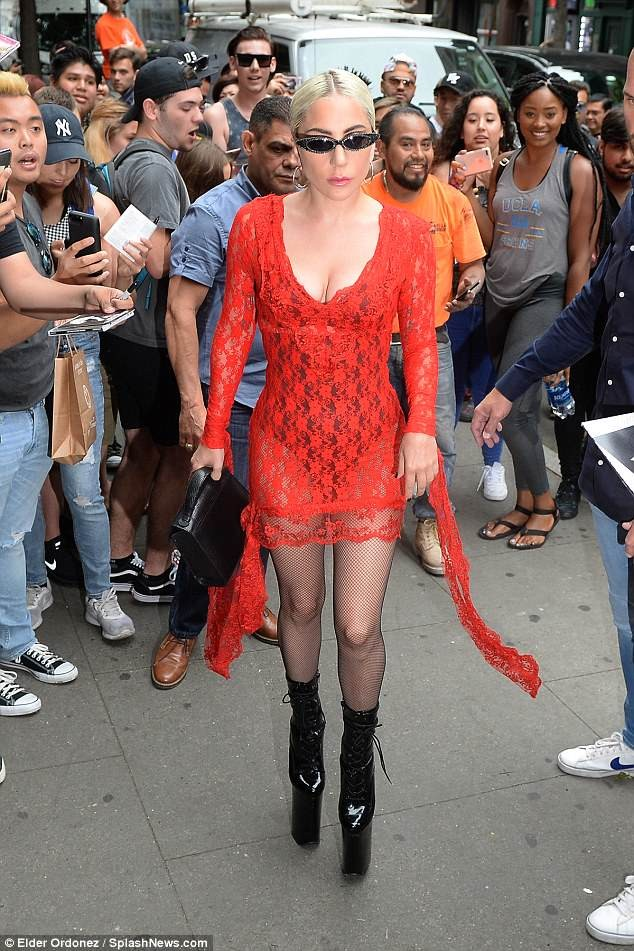 Lady Gaga flashes her underwear in red tight dress as steps out in New York in very high black heels (Photos)