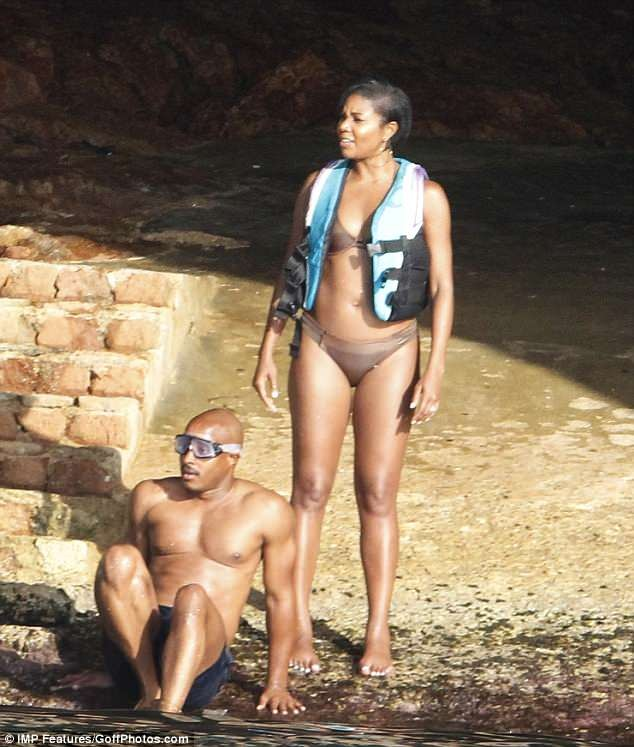 Gabrielle Union flaunts her enviable body in nude bikini as she goes on a boat trip with husband Dwyane Wade (Photos)