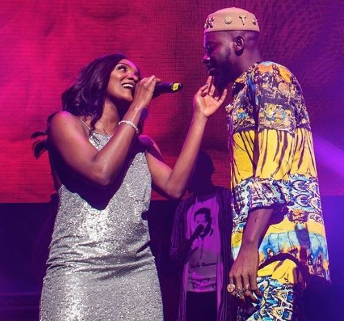 Lovebirds, Adekunle Gold and Simi cuddle on stage during his sold out concert in London (Photo)